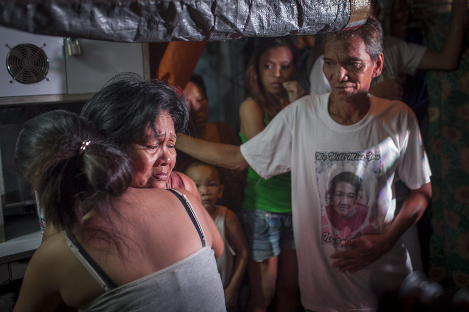 A distraught mother breaks down upon learning the death of her son, an alleged drug user.